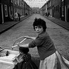 GB. NORTHERN IRELAND. In the narrow terraced streets built for the working people of Northern Ireland (every house except the last needs only three walls), the closely knit communities of differing religious persuasions are encouraged to battle one another. 1965