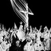 "USA. Hico. The Ku Klux Klan Rally. ""Cross lighting"" ceremony (don't say ""Cross burning"") of the KKK  in the USA. The 10 meter high cross is lit by the Imperial Wizard Tom Robb from Harrison, Arkansas and burns for about 20 minutes. The KKK  members salute an walk around the cross as long as it burns. 1990."