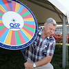 Bill Slisko, a maintenance supervisor, sets-up the color wheel game for the annual Home Days festival at Our Lady Queen of Peace Church in Grafton on July 31.  Steve Manheim