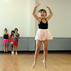 Khloe Racz, 5, of Elyria, front, learns how to jump on the first day of Ballet and Jazz Combo Class at Elyria YWCA Summer Dance program on July 7.  In rear are Alyssa Thompson, Adrianna Rotuno and Bella Truxall.  The class continues through the week.  Steve Manheim