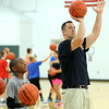 Elyria firefighter Mark Slack instructs Jeremiah Eldemire, 10, of Elyria, in free-throw shooting at the Reach and Rise Elyria Firefighters Basketball Camp at Elyria South Recreation Center on July 28. The firefighters' weeklong camp is designed to foster one-on-one relationships with Elyria youth, while teaching basketball fundamentals, sportsmanship and teammwork. STEVE MANHEIM/CHRONICLE