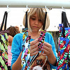 Samantha Retuerto, 10, of Avon Lake, browses through the headbands at Sheila Bee headbands of Westlake at the ninth annual Summer Market at Veteran's Memorial Park in Avon Lake on July 25.  The market features vintage, handmade and beach-themed wares, including furniture, art, clothing, fresh produce, home docor and antiques.  The market continues Sat. from 9 am to 5 pm. STEVE MANHEIM/CHRONICLE