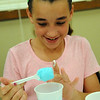 Hannah Garcia, 11, of Elyria, mixes borax, corn starch, hot water and glue to make a bouncy ball at the Mad Science Camp at East Recreation Center on July 23. STEVE MANHEIM/CHRONICLE
