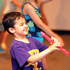 Adam Bearer and The Avon Recreation Youth Theater Camp and Magic Camp perform for families at Avon Lions Community Cabin in Avon on July 11.  STEVE MANHEIM/CHRONICLE