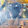 Mike Sampson of Pigfoot BBQ in Medina cooks ribs at the first annual Ribs on the River at Black River Landing in Lorain on July 31.  Award winning National Rib vendors, live entetainment, vendors and children's games are at the event.  Hours will be Friday 4 to 11 pm , Sat. 11 am to 11 pm, and Sunday 12 to 7 pm.  Steve Manheim