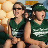 Members of the Crickets girl scouts softball team ride on a float in the 53rd annual Sheffield Lake Community Days parade on July 10. STEVE MANHEIM/CHRONICLE