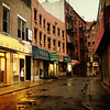 <h2>Doyers Street - Rain -  Chinatown - New York City </h2> - By Vivienne Gucwa<br><br>  On evenings when the sky<br><br>  seduces the city<br><br>  with its tears of happiness, <br><br>  the streets shine<br><br>  in the gleam of nearby lights.<br><br>  And broken-hearted alleys <br><br>  wind their way<br><br>  through the empty recesses <br><br>  of lover's hearts<br><br>  as the city soaks<br><br>  in the warm afterglow <br><br>  of what the sky has wrought.<br><br>  ---<br><br>  This view is of Doyers Street, a winding alley in Chinatown, New York City during a summer rainstorm.<br><br>  ---<br><br>