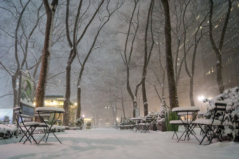 New York Winter Night - Bryant Park Covered in Snow - By Vivienne Gucwa  On a beautiful winter night in midtown Manhattan during winter storm Nemo, snow fell onto the city creating the most enchanting winter landscapes. This photo was taken in Bryant Park while the snow was still falling.   ---