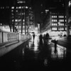 New York City - Rain and Wet Sidewalks - By Vivienne Gucwa  Through eyelashes wet with rain,  a thousand thoughts fall  to the ground   and through the raindrops  the city lights blur together  as shadows make their way  into the night -   impermanence  registered with  every blink.  ---