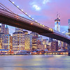 <h2>Brooklyn Bridge and New York City Skyline - City Lights </h2> - By Vivienne Gucwa<br><br>  It's interesting how photos take on a life of their own with long exposure photography. This was taken on a cold night recently as a storm was rolling in. I waited patiently in between stubborn sustained wind gusts as the water from the East River lapped at the edges of Brooklyn Bridge Park gushing over the sides every so often as if to foreshadow what the clouds were hoping to do to the city. <br><br>  As storm clouds moved in and the increasingly darkening sky turned various shades of purple and blue shortly after a relatively subdued sunset, there were a few minutes of calm silence. And as the water played nice and the wind decided to run its own marathon elsewhere, 4 seconds were there for the capturing before the skies unleashed their watery exclamations in the form of rain. <br><br>  This is one of the more popular vantage points for photography of the Brooklyn Bridge. The skyscrapers belong to the Financial District. Prominent structures and buildings include: the Woolworth Building, New York by Gehry (at 8 Spruce Street), One World Trade Center (also known as 1 WTC and/or the Freedom Tower), Pier 17 and the South Street Seaport.<br><br>  ---<br><br>