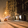 New York Winter Night - Snow on a City Street - By Vivienne Gucwa  On a winter night in New York City, snow falls onto the street and fire escapes as a couple walks along icy sidewalks during a beautiful winter storm. This was taken during winter storm Nemo as the snow blanketed Manhattan.  ---