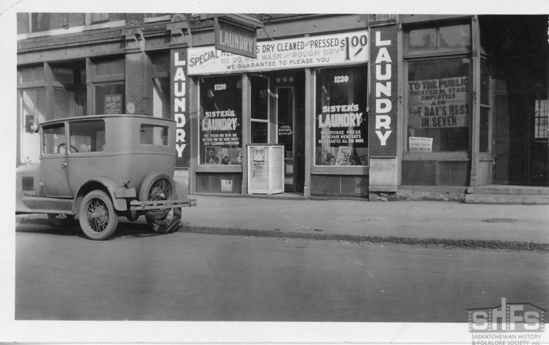 [Model A Ford in front of a laundromat, Winnipeg, 1930s]