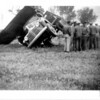 [Combine tipped over truck, 1947]