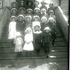 [27 Girls in Hats on the Steps of the Forget Church, around 1915]