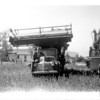 [Combine on top of truck, 1947]