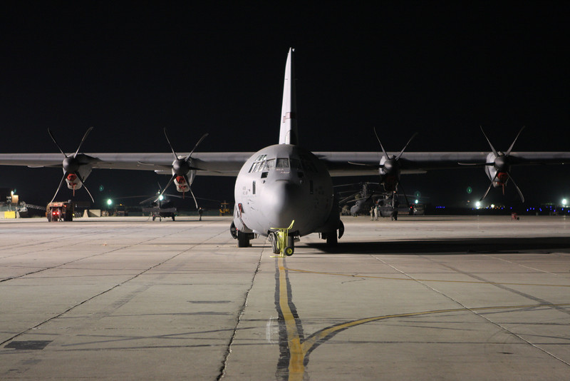 A C130J on the tarmac, at about 1 AM.<br /> I took this shot from inside the back of another C130J.