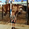 Edwin, age 3.5, horses around in the horse barn at the Lorain County Fair.