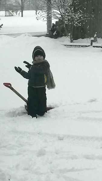 Silas, 3, plays in the snow.