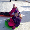 Cara, 12, and Leah, 6, get ready to go sledding.