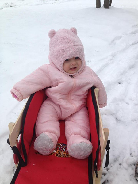 Olivia, 10 months, takes her first sled ride