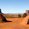 Navajo Dwellings in Monument Valley, Arizona with Mitchell butte and Gray Whiskers in background,