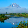 North America, USA, Wyoming, Jackson, Grand Teton N.P., A Foggy Mt. Moran reflected in Snake River Oxbow