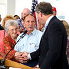 Surrounded by family members, Catherine Lockhart and her husband, Eugene Lockhart, 90, shake hands with Sen. Sherrod Brown. Lockhart was awarded a Bronze Star for his service in WorldWar II. BRUCE BISHOP/CHRONICLE
