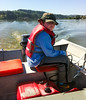 Sam doing a great job of driving the fishing boat on Devils Lake
