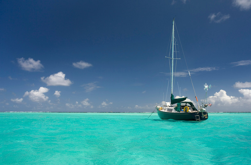 A lone cruising sailboat on the Caribbean.