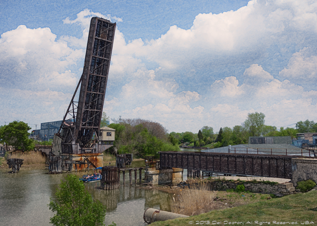 """Railroad bridge, across the Black River, Port Huron, Michigan. This view looks more or less eastward.<br /> <br /> Photographed using Sony RX100 digital camera: 1"""" sensor (13.2mm x 8.8mm), 20.9 megapixels; set to f/5.6 at 1/500-second exposure, ISO 80; daylight. Composed for 10 x 8 aspect ratio; raw to jpeg. Processed in Adobe Photoshop Elements 10.<br /> <br /> Photographic equipment: Woodward Camera, Birmingham, Michigan<br /> <br /> May 19, 2012"""