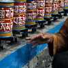 Buddhist monk spinning the prayer wheels at Diki Gompa, Bagarchhap, Annapurna Circuit, Nepal