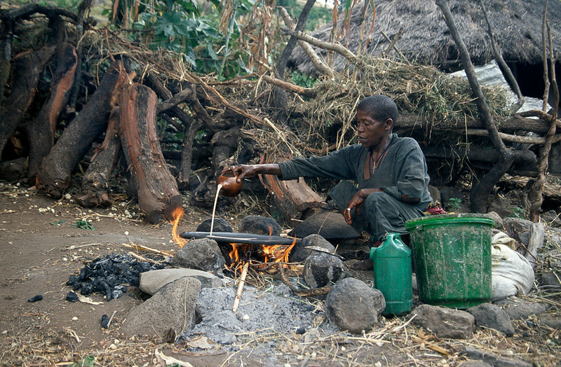 Person making injera on a fire outside, Blue Nile Falls area, Northern Ethiopia