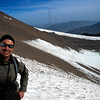 Happy hiker on the snowy slopes of M'Goun mountain, High Atlas, Morocco