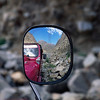 Mirror view of jeep and mountains, road from Hushe to Khaplu, Baltistan, Pakistan
