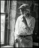 Artist Lowell Davis and his signature corn cob pipe at Red Oak II