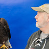 I just had to show you this photo.  In the middle of March I was at the National Eagle Center in Wabasha, MN, to attend their SOAR Festival.  One of the activities they offered was to have your picture taken with Was'aka, one of their male education Eagles.   I'm not sure how to interpret the look I'm getting from Was'aka.  He looks really insulted.