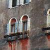 Rusty window boxes in Venice, Italy
