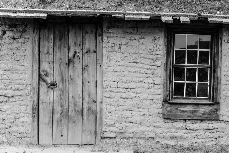 A door and window:  the universal metaphor for entering into and looking out. Like many image aficionados I am drawn to such subjects not because I think we need more lame visual metaphors but simply because such subjects pose without complaints.