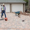 Earl Flores Sr. helping with the paver installation.