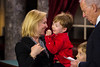 U.S. Senator Kirsten Gillibrand (D-NY) (left) and sons Henry (b. 2008) and Theodore (b. 2003) participate in a reenacted swearing-in with Vice President Joe Biden. In photo, Henry seems to be trying to get Mom's attention. The ceremonial event took place in the Old Senate Chamber inside the U.S. Capitol Building in Washington D.C. on January 3, 2013. The official swearing-in ceremony happened earlier in the Senate chambers on the opening day of the 113th Congress. (Photo by Jeff Malet).