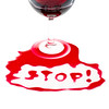The word Stop written with poured red wine