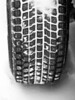 Mud and snow tire tread packed with snow