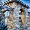 cultured stone terrace trellis details near park in a city