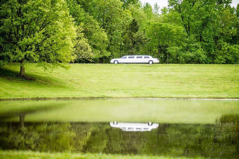 white limo reflecting in lake