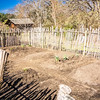Small vegetable garden with risen beds in the fenced backyard