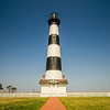 bodie island lighthouse with clear blue sky