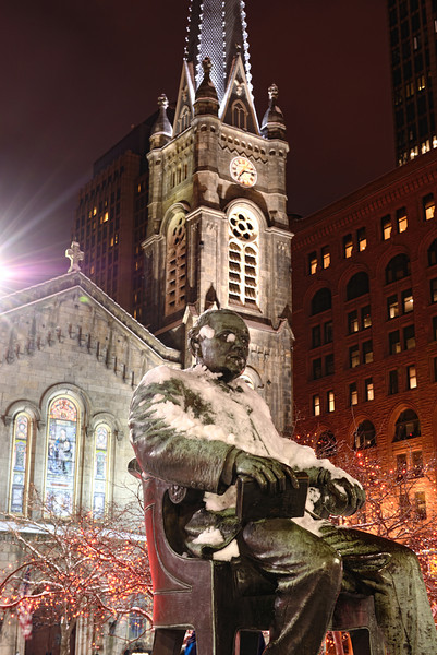 Tom Johnson Statue and the Old Stone Church