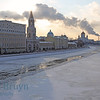 Kremlin on cold and frozen day with ice side walk accross from Moscow river in Moscow Russia