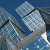Modern building at Moscow City on sunny day and blue sky with shiny glass and steel in Moscow Russia