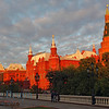 State Historical Museum in bright yellow late afternoon sunshine with clouds in Moscow Russia